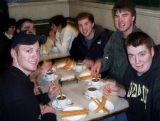 students eating churros in Madrid.JPG